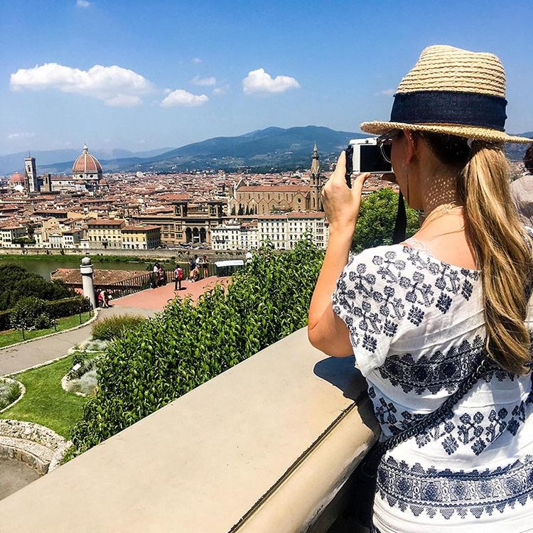 Kendra Scott taking a photo while overlooking Florence. Kendra Scott's 2017 Fall Line was inspired by her trip to Tuscany.